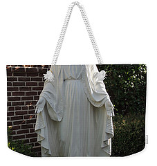 Weekender Tote Bag featuring the photograph Woman Of Faith by Aaron Martens