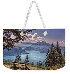Weekender Tote Bag featuring the photograph Wooden Bench by Hanny Heim
