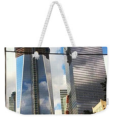 Weekender Tote Bag featuring the photograph World Trade Center Twin Tower by Susan Garren