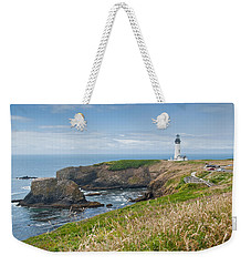 Weekender Tote Bag featuring the photograph Yaquina Head Lighthouse by Jeff Goulden