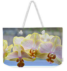 Yellow And Pink Orchids Weekender Tote Bag by Tine Nordbred