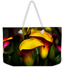 Yellow And Red Calla Lily Weekender Tote Bag by Menachem Ganon