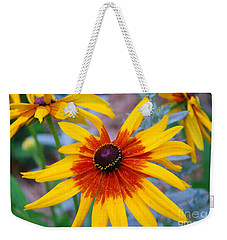 Weekender Tote Bag featuring the photograph Yellow Burst by Allen Beatty