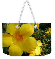 Weekender Tote Bag featuring the photograph Yellow Flower by Kristine Merc