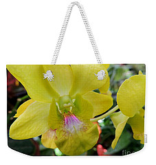 Weekender Tote Bag featuring the photograph Yellow Orchid by Kristine Merc