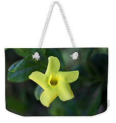 Weekender Tote Bag featuring the photograph Yellow Trumpet Flower by Ramabhadran Thirupattur