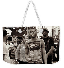 Weekender Tote Bag featuring the photograph Young Man And Guy With Cap - Times Square by Miriam Danar