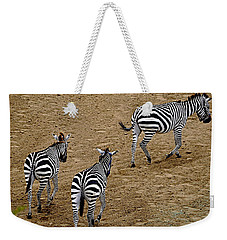 Weekender Tote Bag featuring the photograph Zebra Tails by AJ  Schibig
