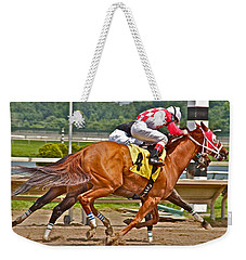 Weekender Tote Bag featuring the photograph  Betting On Number Four by Alice Gipson
