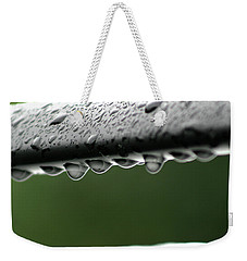 Weekender Tote Bag featuring the photograph  Rain Drops by Emanuel Tanjala