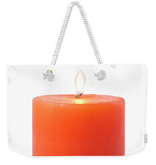 Weekender Tote Bag featuring the photograph  Red Candle by Atiketta Sangasaeng