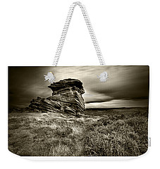 Weekender Tote Bag featuring the photograph  Stone Guardian by Beverly Cash