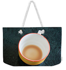 Weekender Tote Bag featuring the photograph A Cup With The Remains Of Tea On A Green Table by Ashish Agarwal