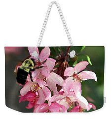 Weekender Tote Bag featuring the photograph Buzzing Beauty by Elizabeth Winter