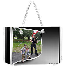 Weekender Tote Bag featuring the photograph Chasing Bubbles by Brian Wallace