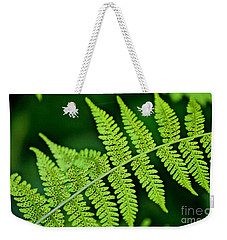 Weekender Tote Bag featuring the photograph Fern Seed by Sharon Elliott