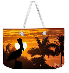 Weekender Tote Bag featuring the photograph Pelican At Sunset by Dan Friend