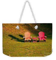 Weekender Tote Bag featuring the photograph Red And Orange Chairs by Les Palenik