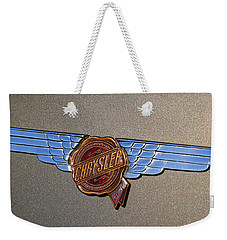 Weekender Tote Bag featuring the photograph 1937 Chrysler Airflow Emblem by Gordon Dean II