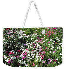 Weekender Tote Bag featuring the photograph A Bed Of Beautiful Different Color Flowers by Ashish Agarwal