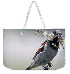 Weekender Tote Bag featuring the photograph A Bird And A Twig by Elizabeth Winter