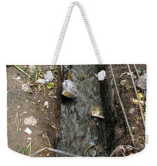 Weekender Tote Bag featuring the photograph A Dirty Drain With Filth All Around It Representing A Health Risk by Ashish Agarwal
