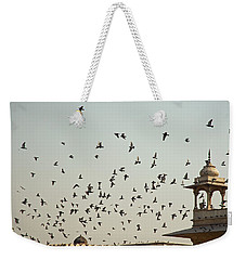 Weekender Tote Bag featuring the photograph A Flock Of Pigeons Crowding One Of The Structures On Top Of The Red Fort by Ashish Agarwal