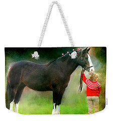 Weekender Tote Bag featuring the photograph A Girl And Her Horse by Davandra Cribbie