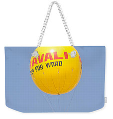 Weekender Tote Bag featuring the photograph A Hot Air Balloon In The Blue Sky by Ashish Agarwal
