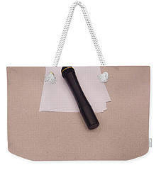 Weekender Tote Bag featuring the photograph A Microphone On The Lectern Of A Presentation Room by Ashish Agarwal