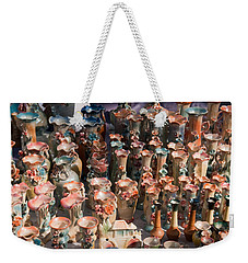 Weekender Tote Bag featuring the photograph A Number Of Clay Vases And Figurines At The Surajkund Mela by Ashish Agarwal