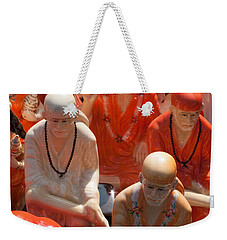 Weekender Tote Bag featuring the photograph A Number Of Statues Of The Shirdi Sai Baba For Sale At Surajkund Mela by Ashish Agarwal