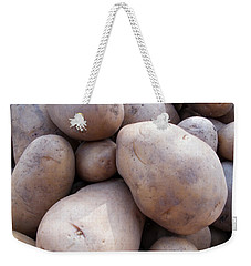 Weekender Tote Bag featuring the photograph A Pile Of Large Lumpy Raw Potatoes by Ashish Agarwal