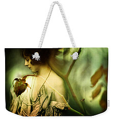 Weekender Tote Bag featuring the photograph A Rose In Winter by Rebecca Sherman