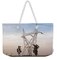 Weekender Tote Bag featuring the photograph A Transmission Tower Carrying Electric Lines In The Countryside by Ashish Agarwal
