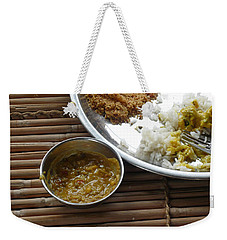 Weekender Tote Bag featuring the photograph A Typical Plate Of Indian Rajasthani Food On A Bamboo Table by Ashish Agarwal