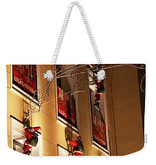Weekender Tote Bag featuring the photograph A Wall Of Sneaky Santas by Lorraine Devon Wilke