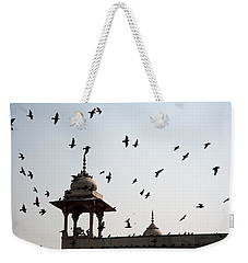 Weekender Tote Bag featuring the photograph A Whole Flock Of Pigeons On The Top Of The Ramparts Of The Red Fort In New Delhi by Ashish Agarwal
