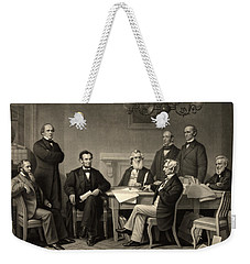 Weekender Tote Bag featuring the photograph Abraham Lincoln At The First Reading Of The Emancipation Proclamation - July 22 1862 by International  Images