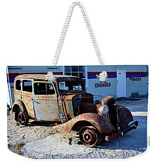 Weekender Tote Bag featuring the photograph ...and Rotate The Tires by Larry Bishop