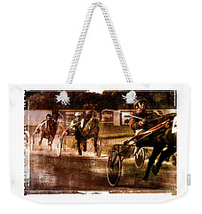 Weekender Tote Bag featuring the photograph and the winner is - A vintage processed Menorca trotting race by Pedro Cardona