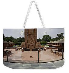 Weekender Tote Bag featuring the photograph Base Of The Jallianwala Bagh Memorial In Amritsar by Ashish Agarwal