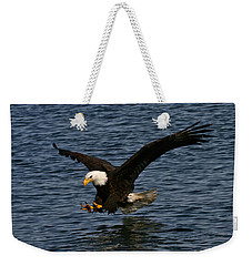 Weekender Tote Bag featuring the photograph Before The Strike by Doug Lloyd