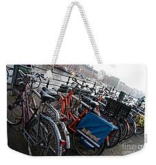 Weekender Tote Bag featuring the digital art Bikes In Amsterdam by Carol Ailles