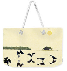 Weekender Tote Bag featuring the photograph birds feeding in the Everglades by Dan Friend