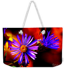 Weekender Tote Bag featuring the photograph Blooming Asters by Susanne Still