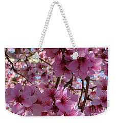 Weekender Tote Bag featuring the photograph Blossoms by Lydia Holly