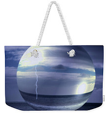 Weekender Tote Bag featuring the photograph Blue Sea Hover Bubble by Vicki Ferrari