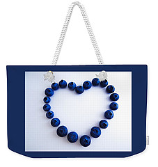 Weekender Tote Bag featuring the photograph Blueberry Heart by Julia Wilcox