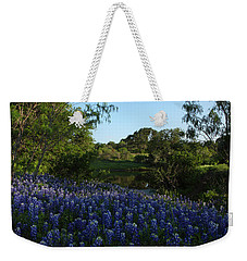 Weekender Tote Bag featuring the photograph Bluebonnets At The Pond by Susan Rovira
